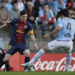 Celta Vigo's Oubina fights for ball with Barcelona's Messi during their Spanish First Division soccer match at the Balaidos stadium in Vigo